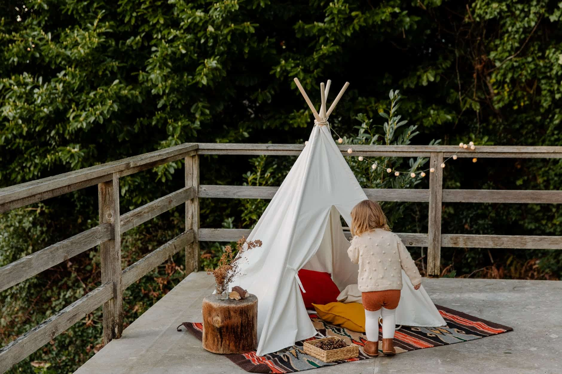 little kid coming in wigwam on terrace -  encourage your child to explore