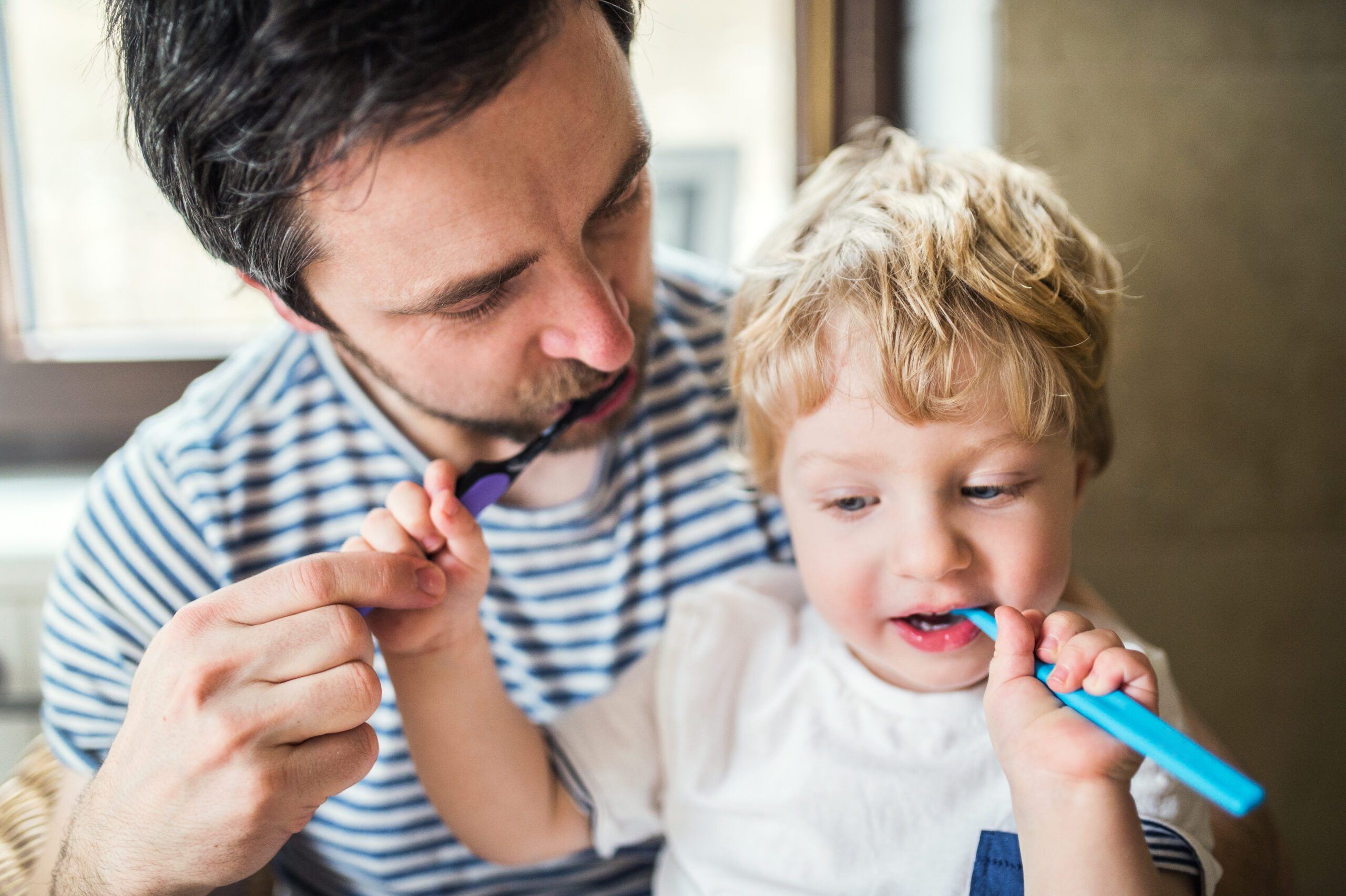 Toddlers equal new found independence.  This milestone does leave many parents asking about tips for teaching a toddler how to brush their teeth. Today, we are going to go over seven amazing tips to make this fun for both parent and child! #parentingtips #parentingtoddlers #oralhygiene #brushingtips #toddlers #baby