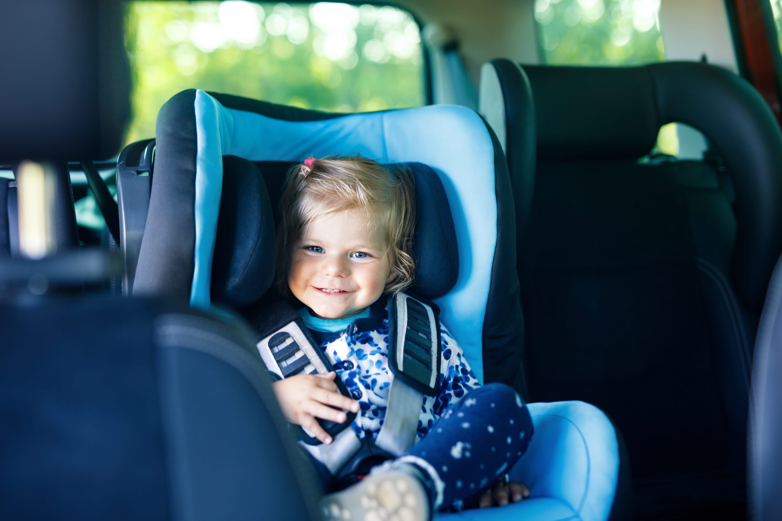 Children spend a lot of time getting places in vehicles. Find out how to travel safely with your kids in the car with these top three tips. #carsafety #parentingtips