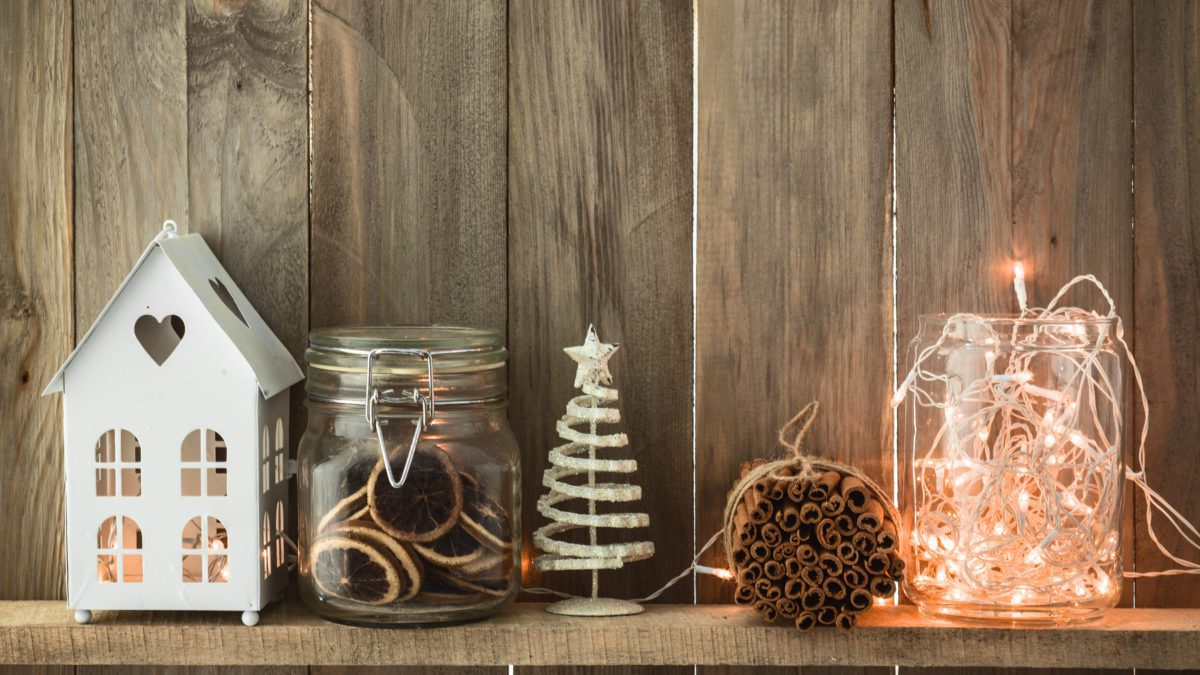 Christmas and winter decor on wooden shelf.