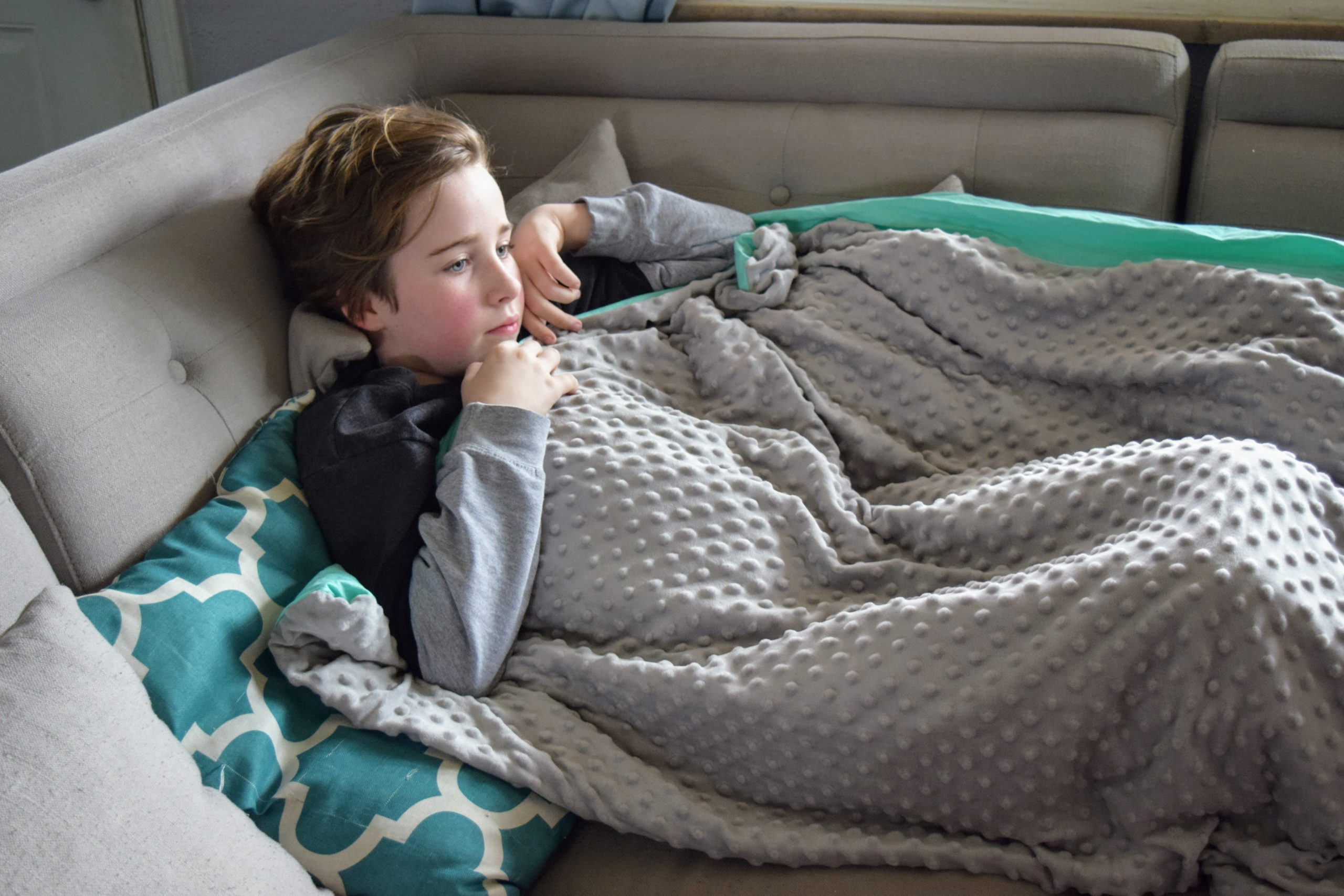 Do weighted blankets help with autism? Keep reading to answer all your questions about weighted blankets for children & adults with autism! #autismparenting #autism #asd #weightedblamket #adhd